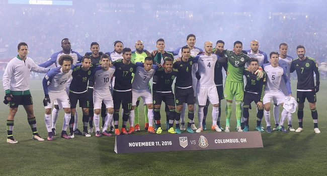 USA and Mexico soccer players gathered together for a photo to show unity